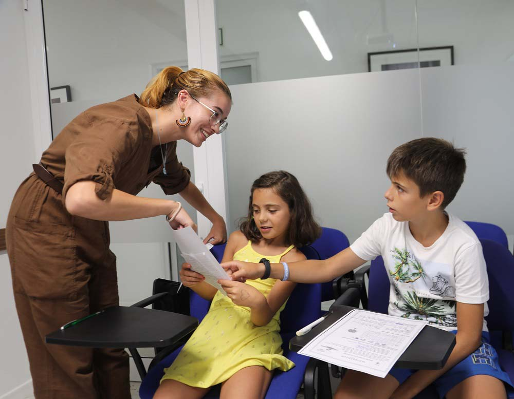 Young learners with their teacher