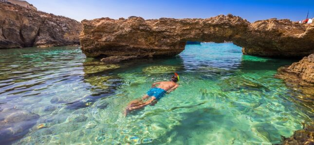 snorkeling in the crystal clear waters of maltese beaches