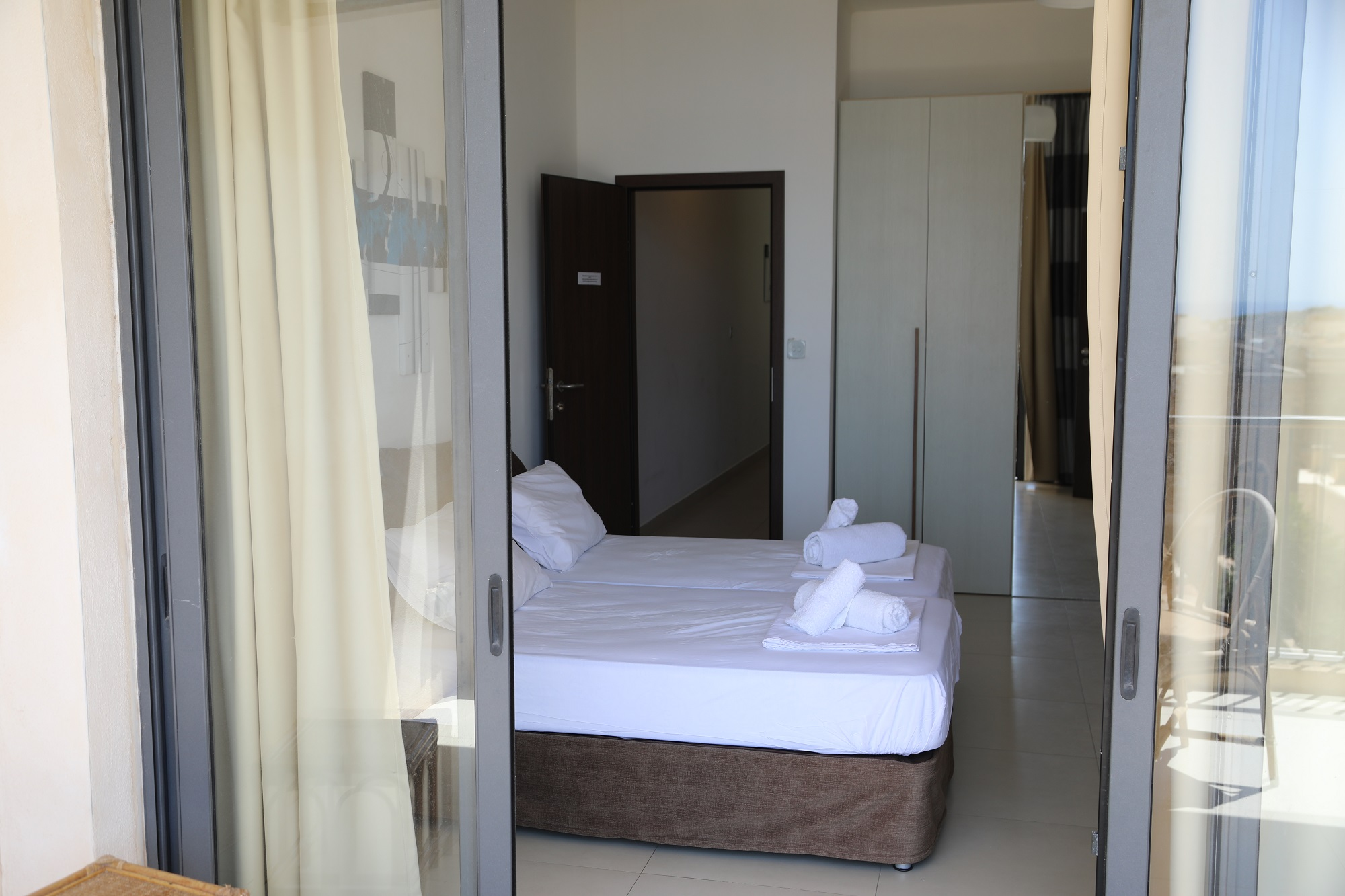 Balcony view bedroom at BELS Gozo residence