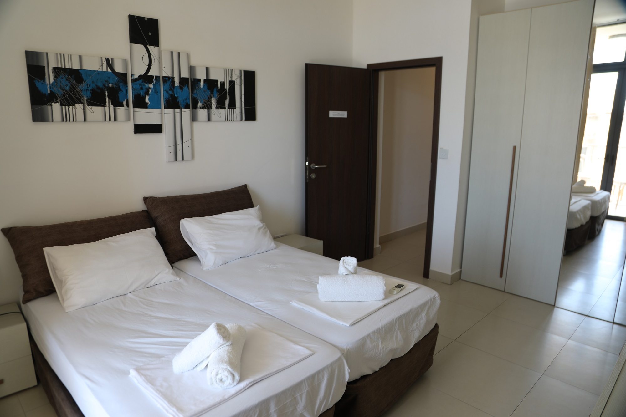 A bedroom at BELS Gozo superior residence