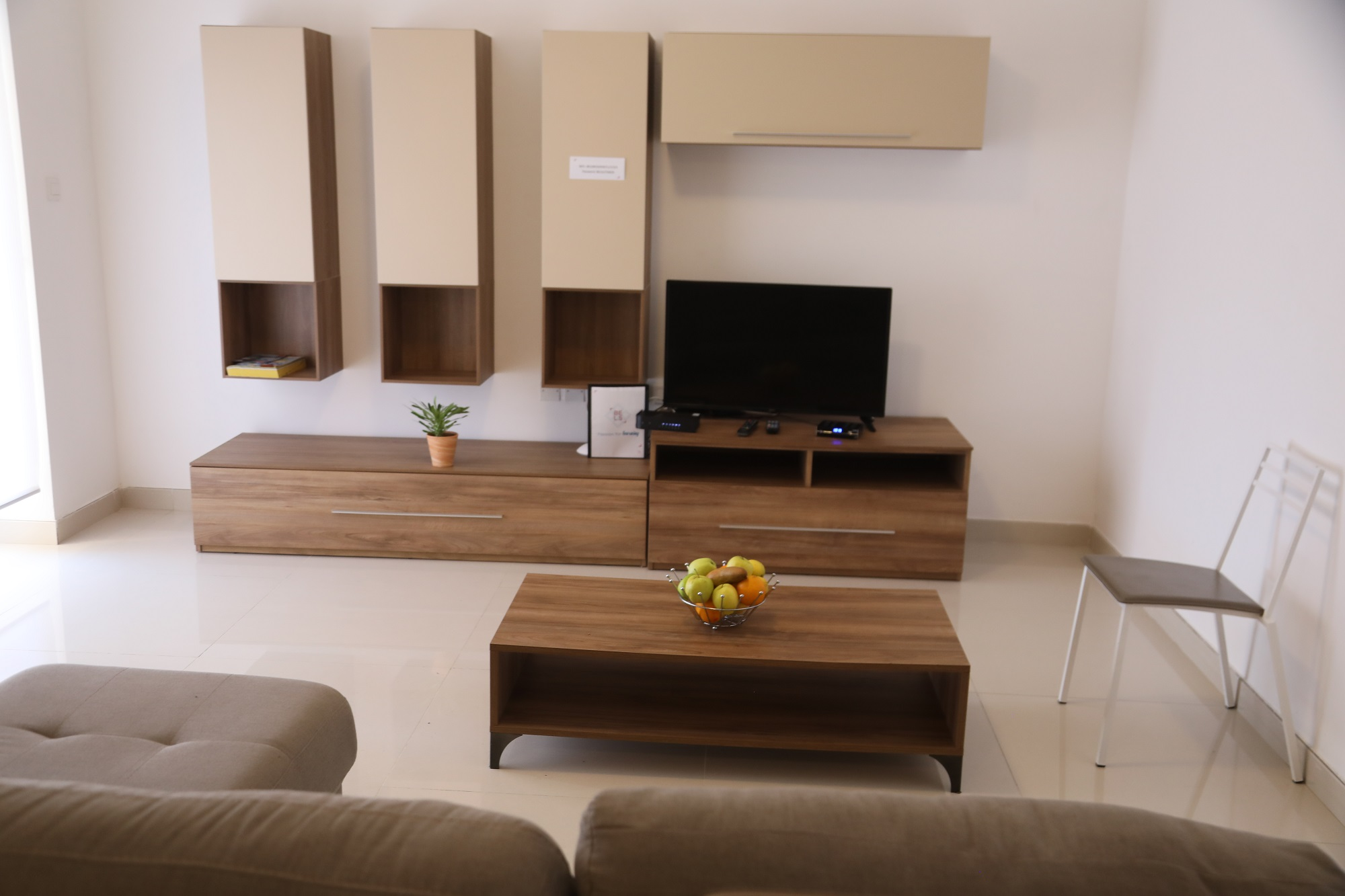 A photo showing the tv and living room in our BELS Malta superior residences